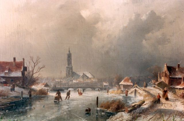 Charles Leickert | A winter landscape with skaters on the ice, Amersfoort in te distance, Öl auf Leinwand, 44,3 x 65,6 cm, signed l.l.